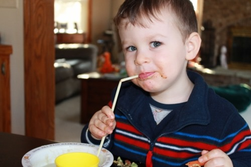 Kids eating creamy cauliflower soup with straws