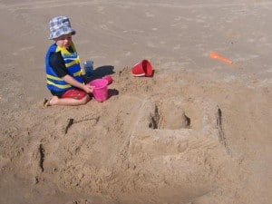 Young boy building a sand castle