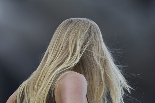 A woman with long blonde hair