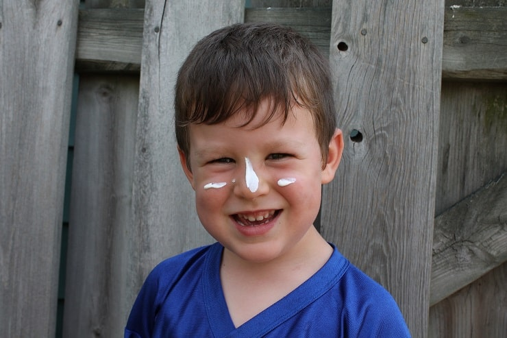 boy with mineral sunscreen on his face