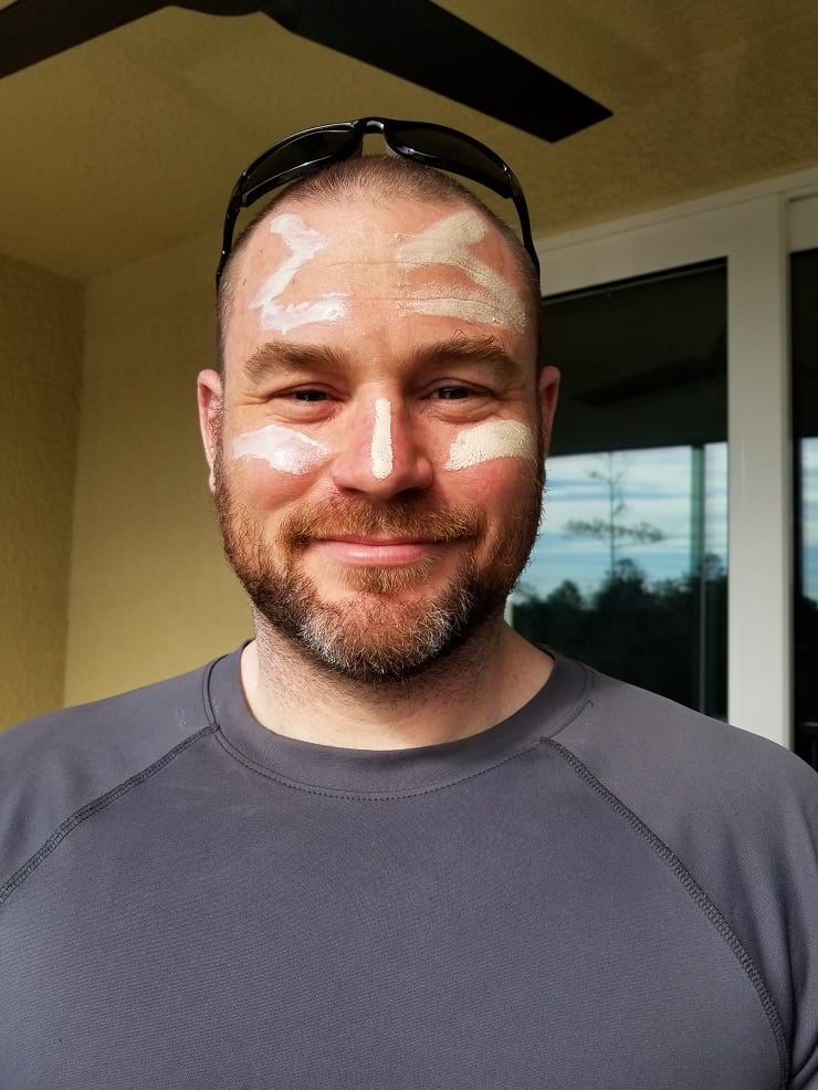 A man with sunscreen on his face looking at the camera