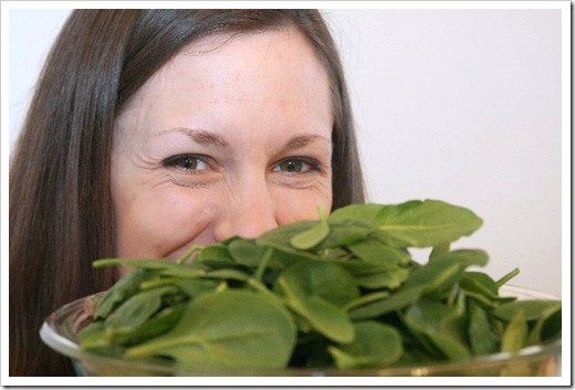 hiding behind spinach smiling