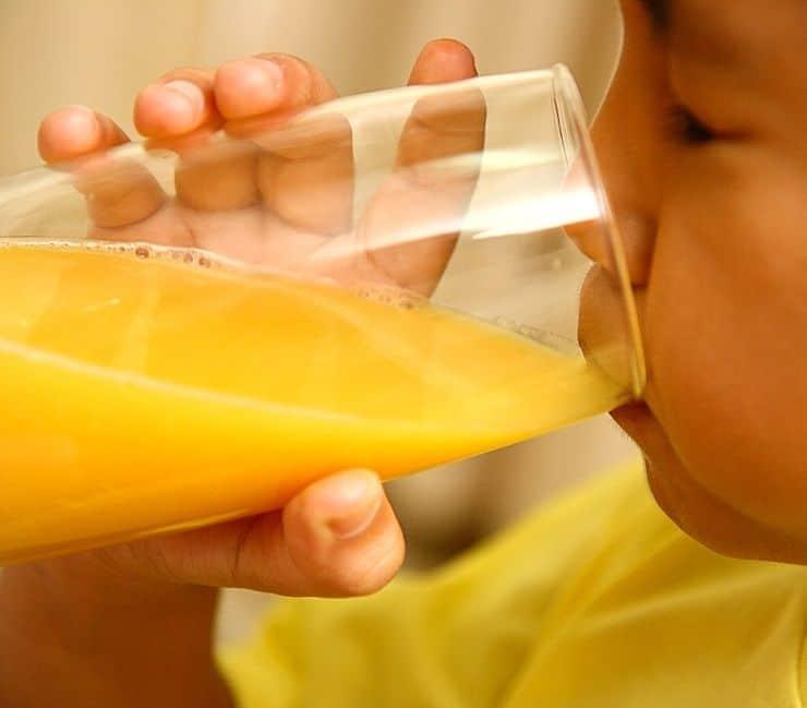 boy-drinking-a-healthy-glass-of-orange-juice_MJx-3Ewd