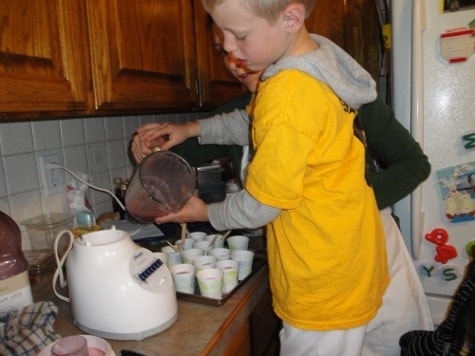 little boy using dairy-free ingredients for homemade popsicles