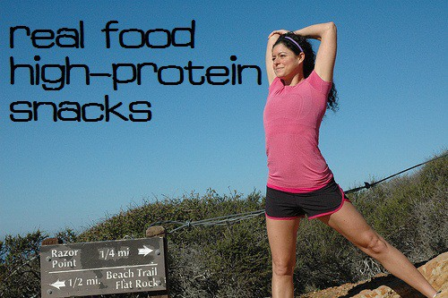 A woman on a hiking trail - real food high protein snacks