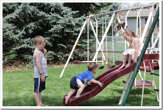 kids playing on new swingset