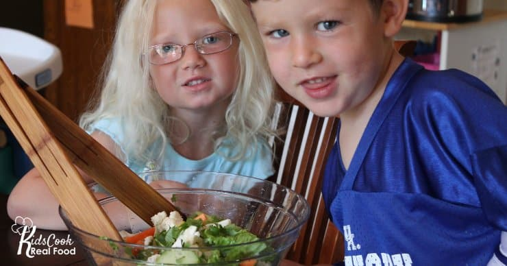 kids with a bowl of salad