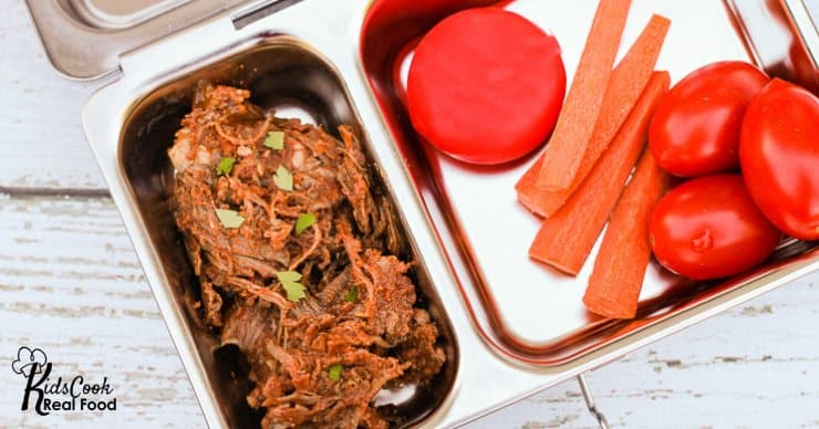 bento lunch with shredded beef, cheese, tomatoes and carrots