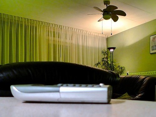 Cordless phone sitting on a table with a couch in the background