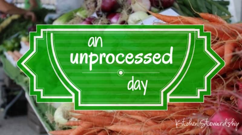 The words \'an unprocessed day\' over a background of vegetables