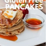Stack of gluten-free pancakes topped with butter and syrup