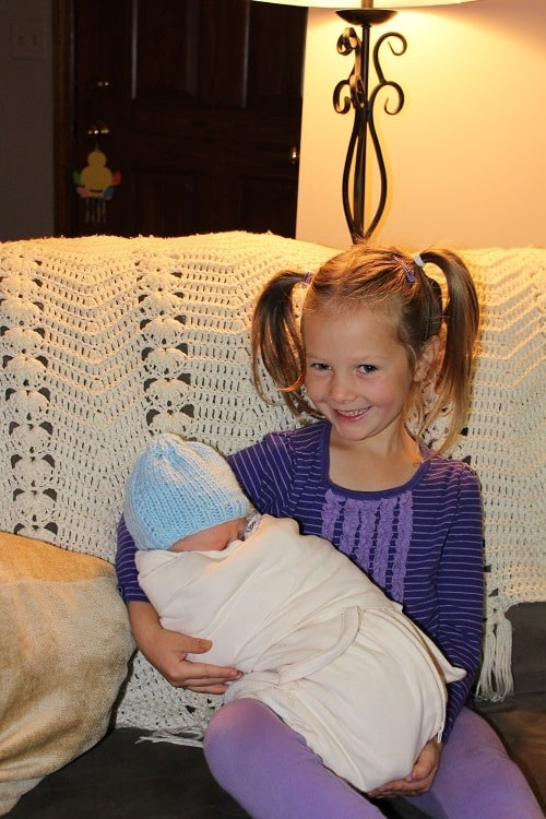 Leah overjoyed to hold baby brother