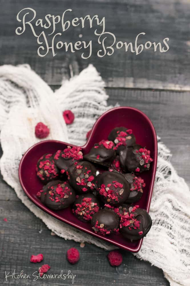 Raspberry Honey Bonbons Recipe - Bitter chocolate, crunchy salt, tart dried raspberries, and a surprising filling of honey. It is hard to go wrong with these bonbons ever, and they are especially suited for Valentine's with their naturally red garnish. :: via Kitchen Stewardship
