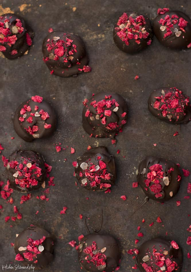 Raspberry Honey Candies recipe- Bitter chocolate, crunchy salt, tart dried raspberries, and a surprising filling of honey. | WorthCooking.net