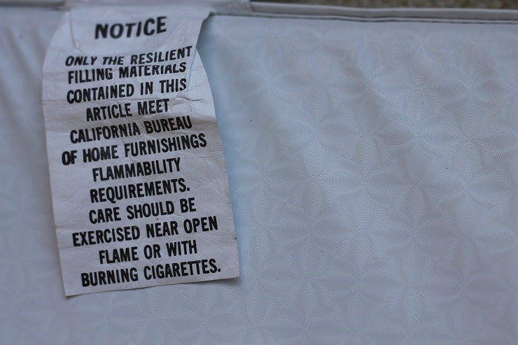 Flame retardant info tag on changing table pad California Bulletin