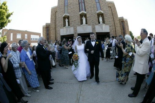 Bride and groom exiting a church