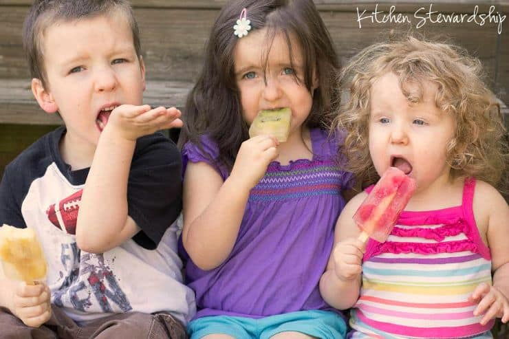 three kids eating diary free frozen treats - Kitchen Stewardship