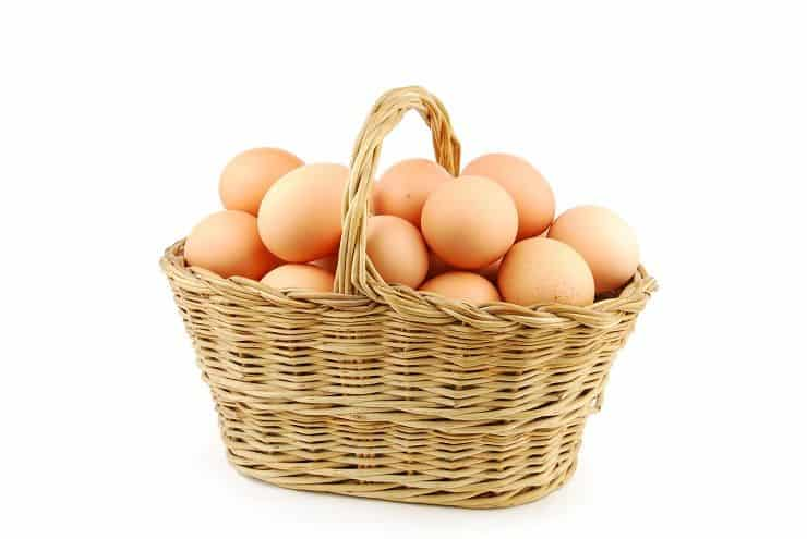 eggs in a wicker basket on white G1k kk RO