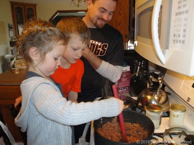 Dad cooking with the kids