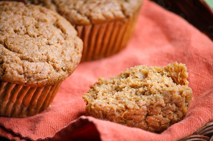 Easy Gluten free Pumpkin Muffins on a red towl.