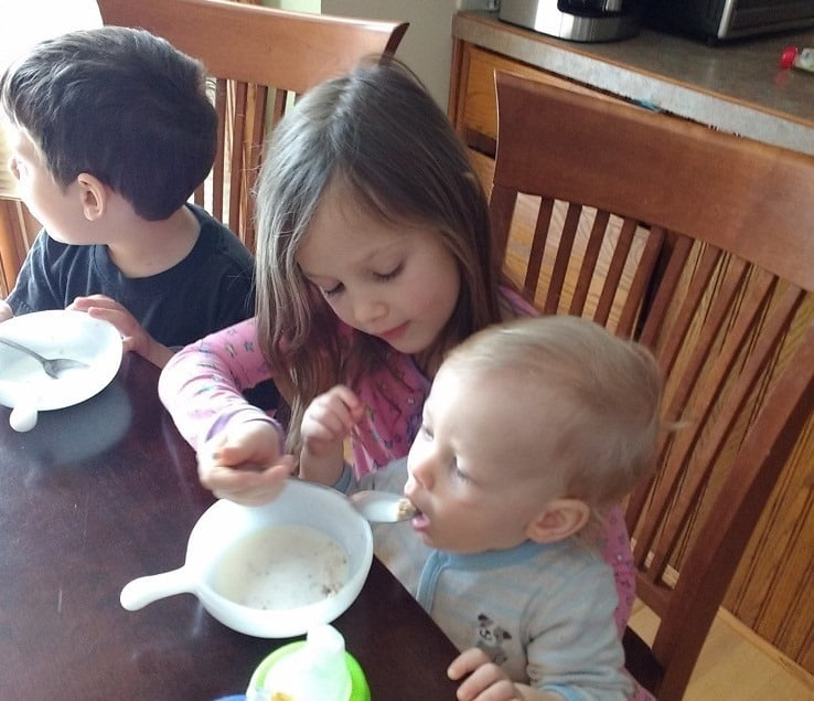 Feeding Gabe oatmeal at the table