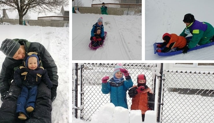 Having fun sledding outside in the winter snow