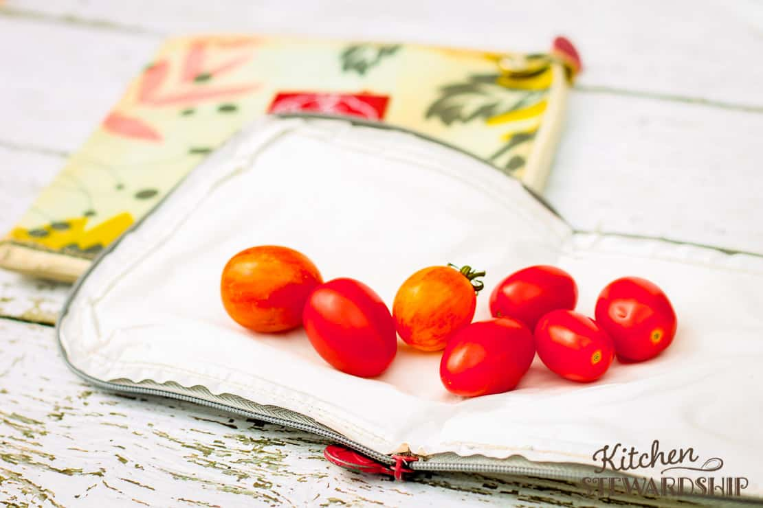 cherry tomatoes on flat reusable snack bag from 2 Red Hens
