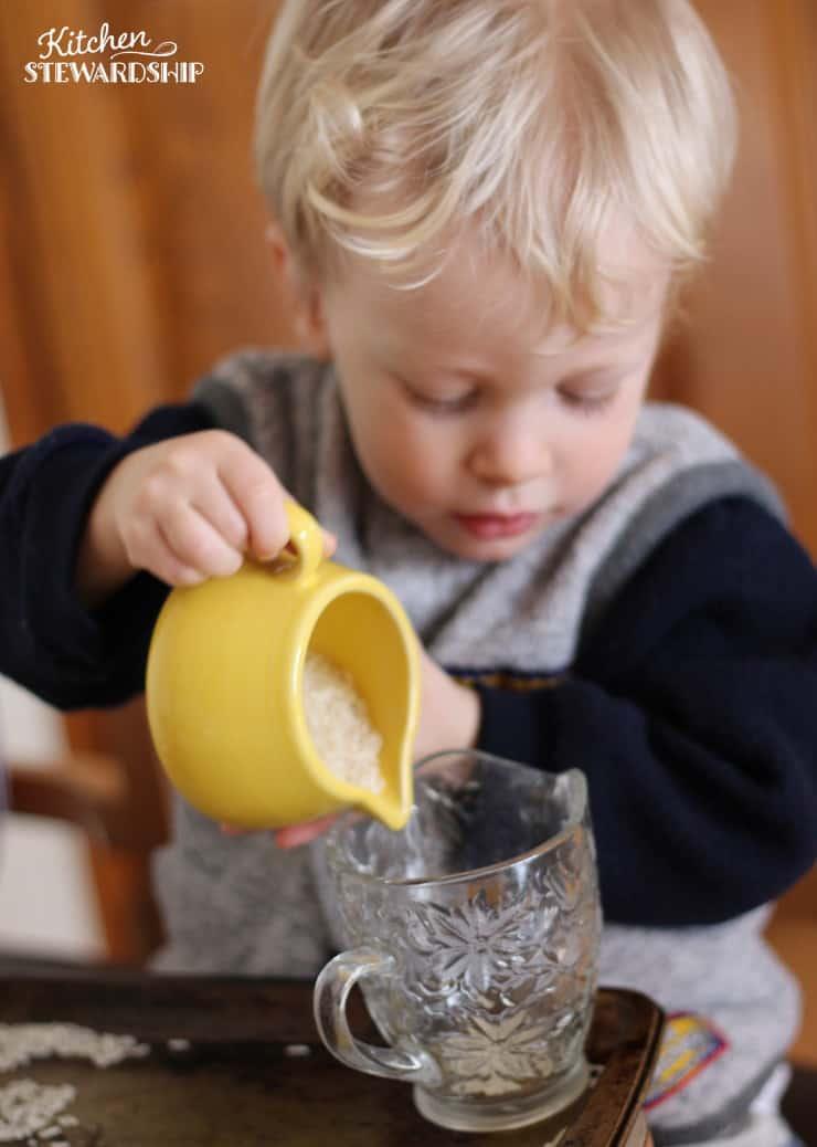 preschooler practicing pouring skills