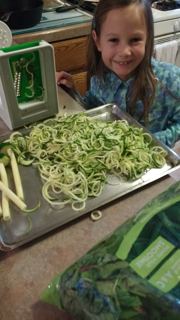 kids help with making zoodles with a spiralizer