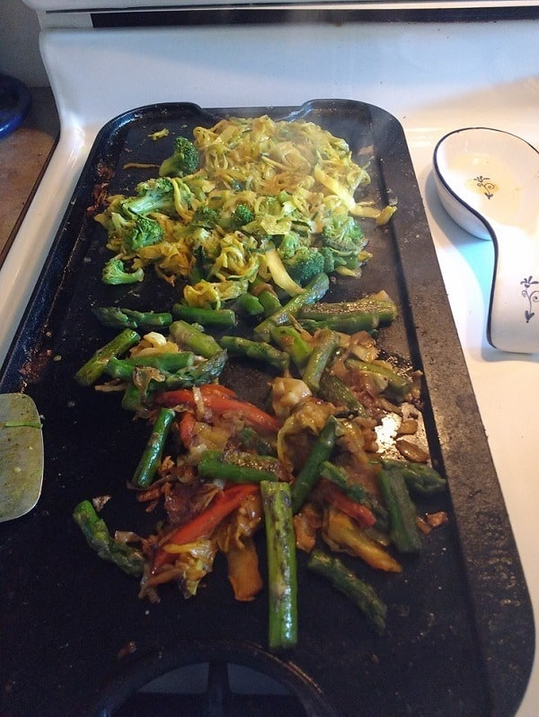 re heating leftover veggies and zoodles on the griddle