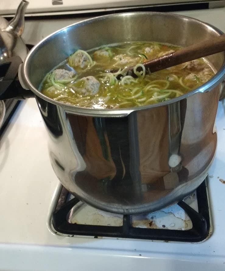 zoodles in huge pot of meatball soup