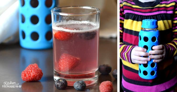 Glass of homemade smart water with strawberries, blueberries and raspberries in it. Picture next to it is of a young girl holding a lifefactory glass water bottle.