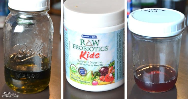 Jars with herbal infusions in them and a bottle of Raw Probiotics Kids.