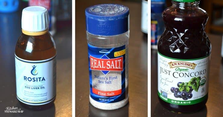 Bottle of Rosita cod liver oil, Redmond Real Salt and organic grape juice.