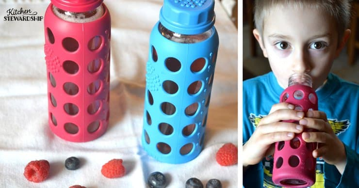 Red and blue lifefactory water bottles on a white towel with raspberries and blueberries. Picture the right shows a young boy drinking from the red water bottle.