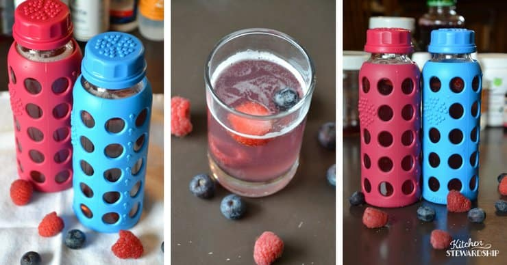 Red and blue lifefactory water bottles with homemade smart water in a glass and blueberries and raspberries.