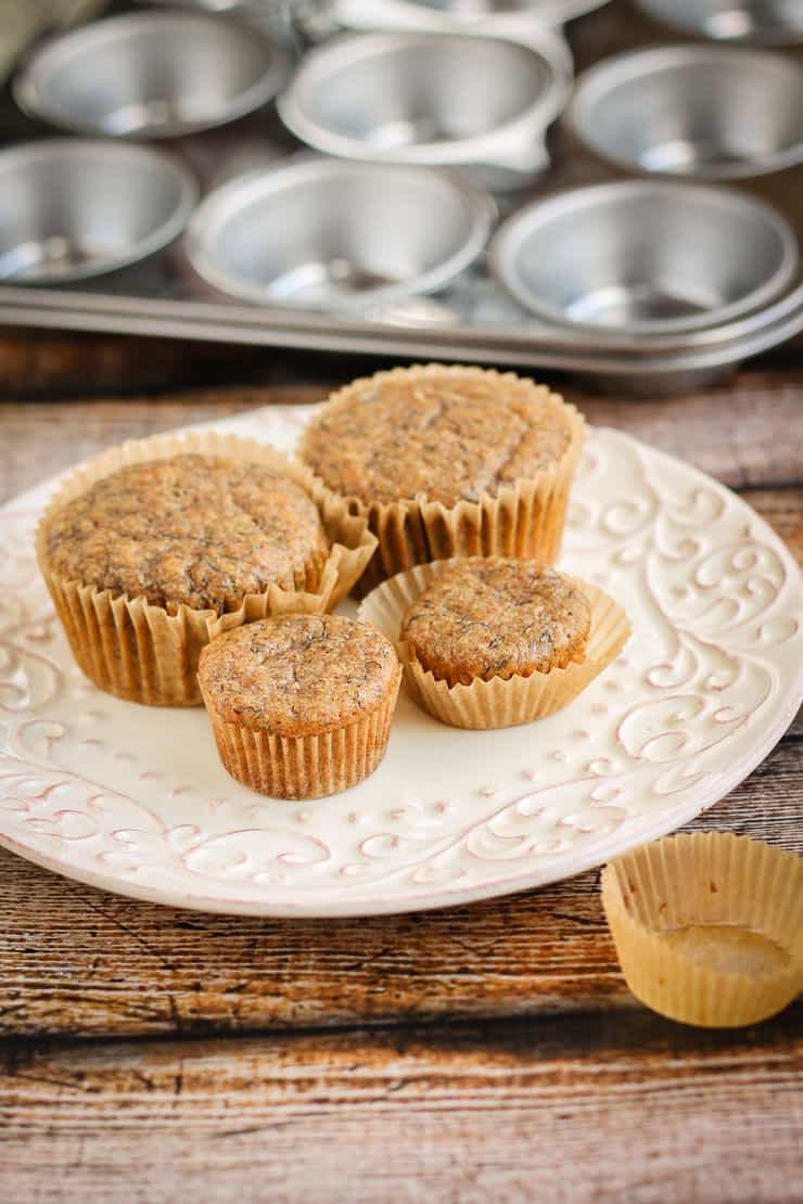 100% Whole Grain Spelt Banana Muffins on a plate.