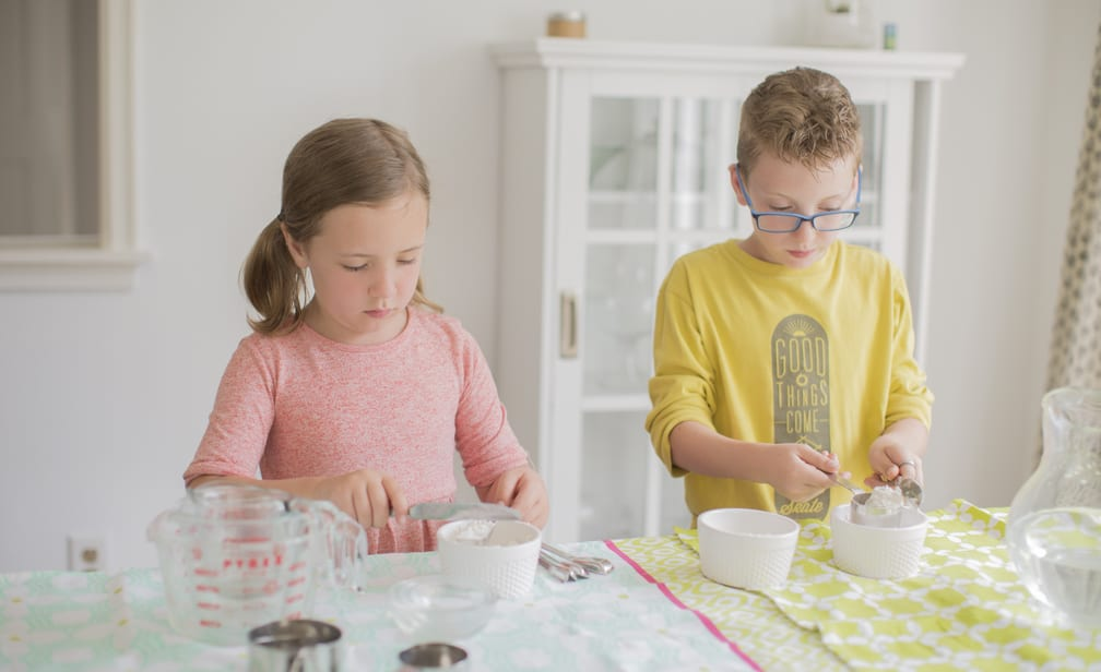 kids measuring flour flat for baking