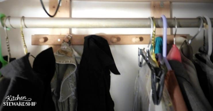 Increase closet space with hooks behind the rod.