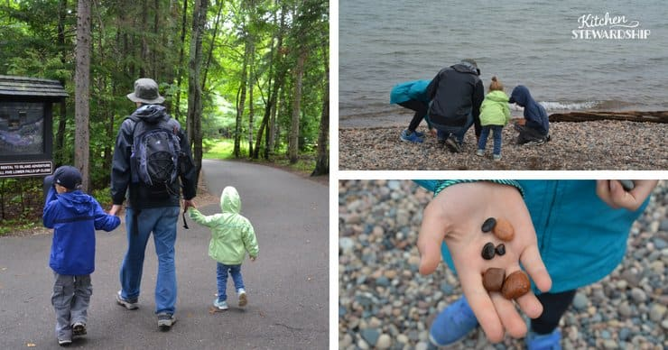 Kids and their dad hiking and exploring the beach at a local lake.