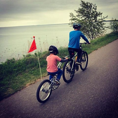 children riding tandem bike