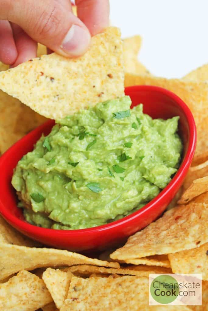 tortilla chip dipped in homemade guacamole