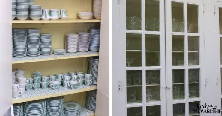 cabinet of glass dishes, mugs and plates.
