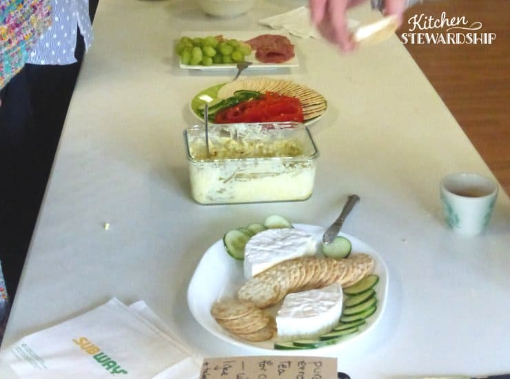 church potluck; hummus, cheese, crackers, vegetables