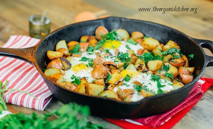 crispy potatoes and eggs in a skillet