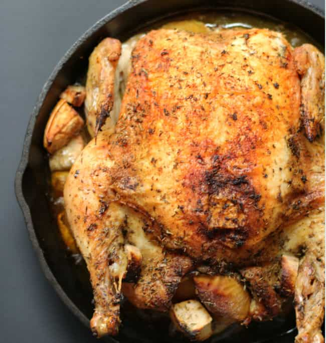 whole roasted chicken in a cast iron skillet