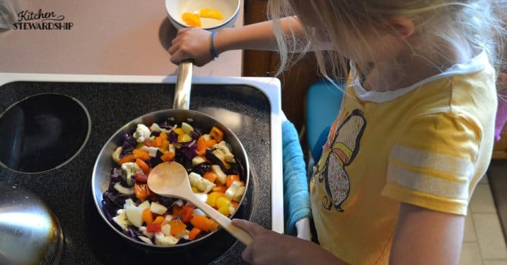 young girl cooking vegetables.