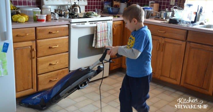 young boy vacuuming
