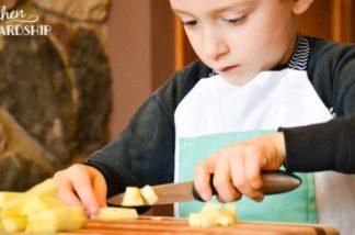 boy cutting apples
