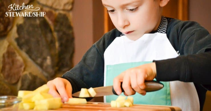 boy chopping fruit
